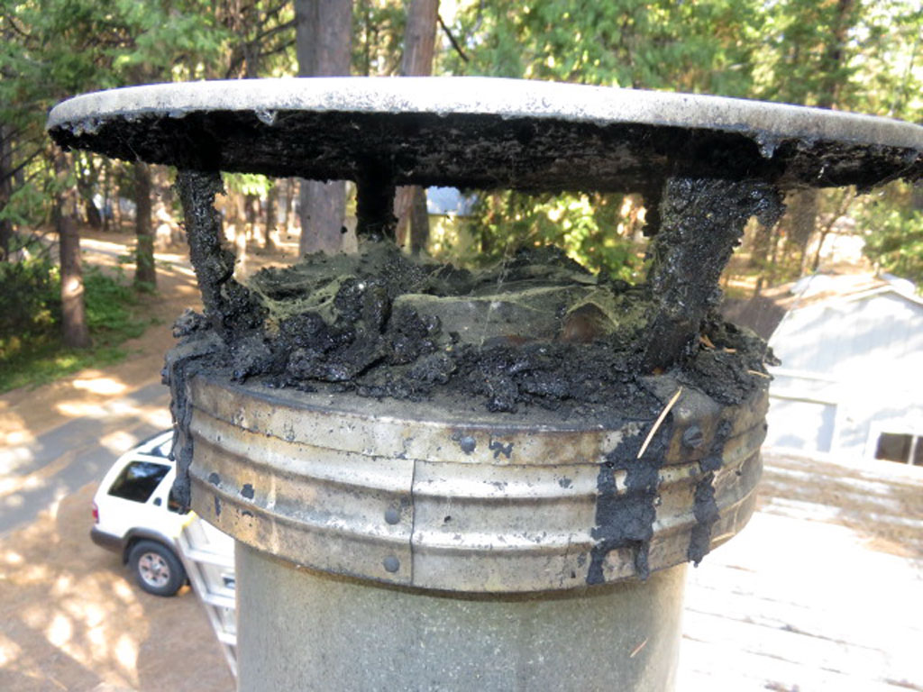 If this is what your chimney looks like it needs to be cleaned and have a spark arrestor screen installed. Creosote buildup can cause chimney fires