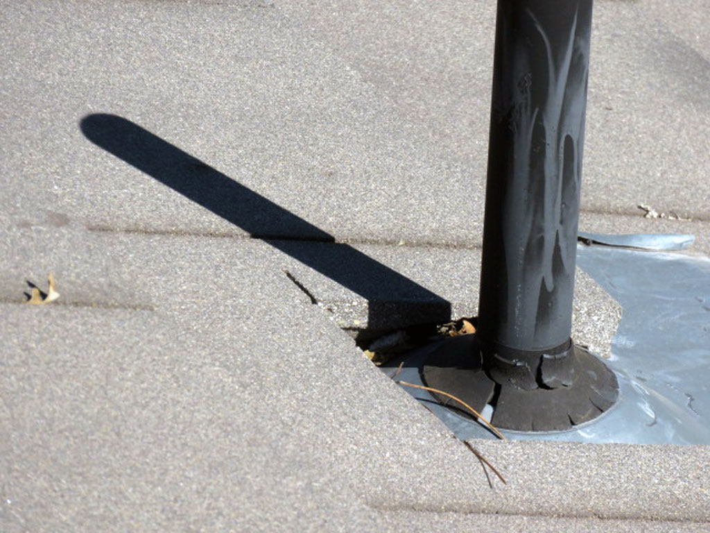 Cracked rubber or mastic seals on plumbing vents at the roofline allow water intrusion