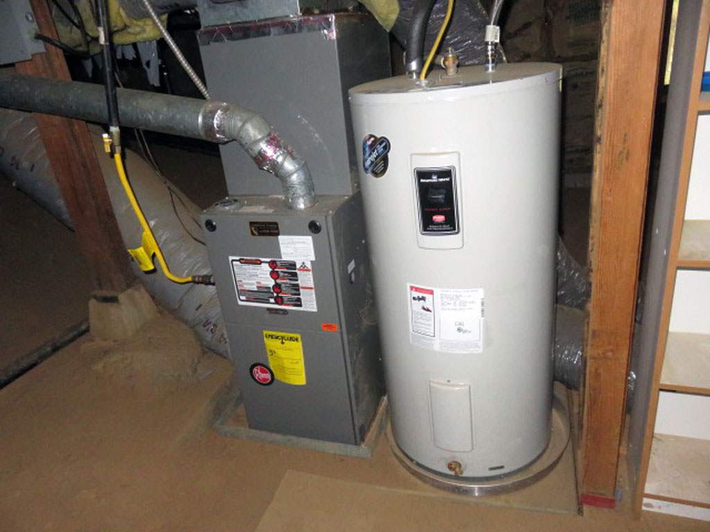 Water heater storage tanks require two approved earthquake straps fastened to the framing with lag bolts in the upper and lower 1/3 of the tank
