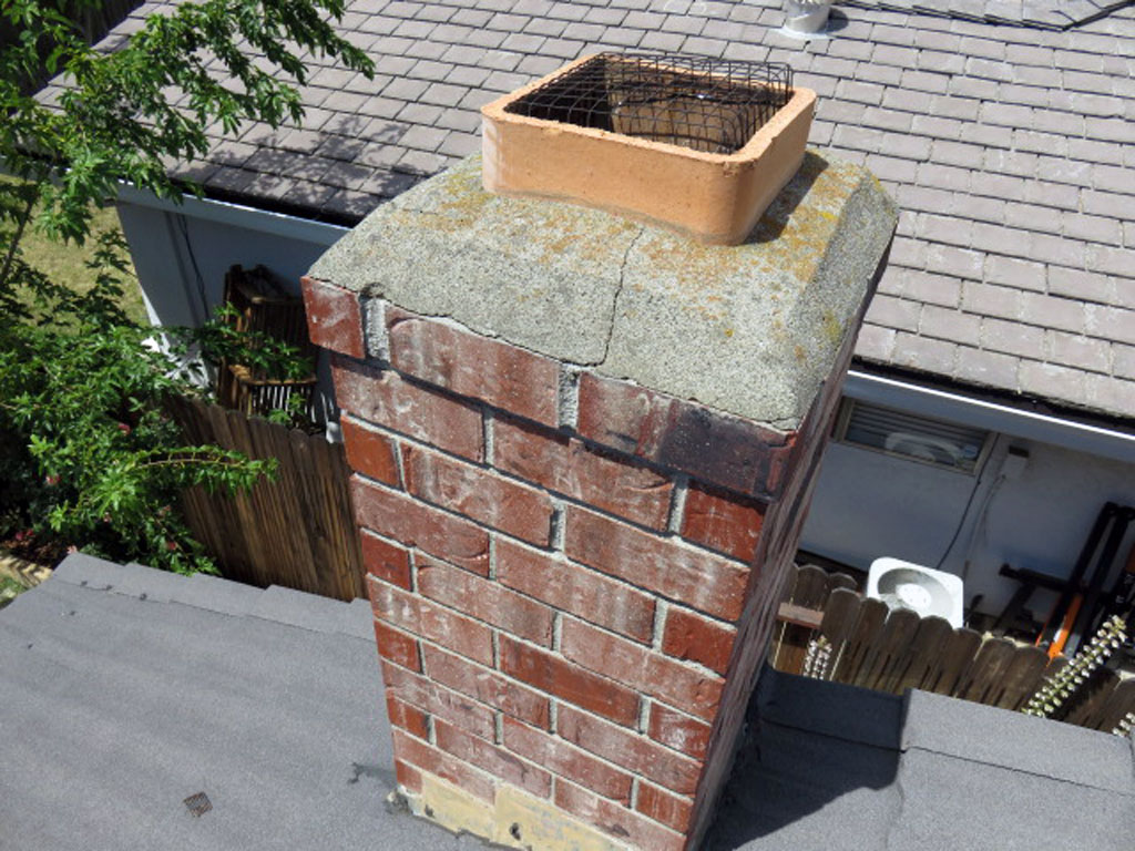 Cracks in the chimney mortar crown should be repaired or the crown replaced if needed