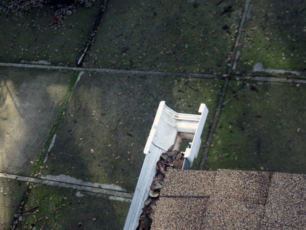 Gutters at the roof are only effective if capped at the end, clean, and include downspouts