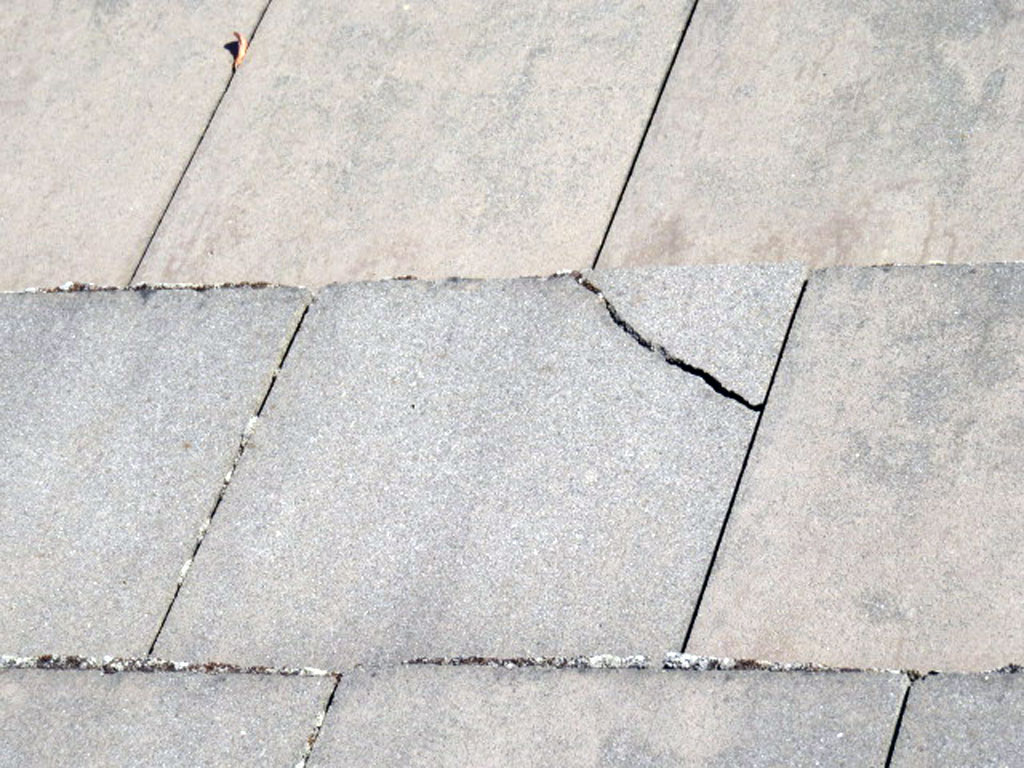 Cracked concrete or clay roof tiles should be replaced not repaired to prevent leakage